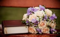 A-Bouquet-of-Flower-Next-to-a-Thick-Book-Book-is-Thus-Smelling-Good-Do-Open-and-Read-It-More-HD-Creative-Wallpaper